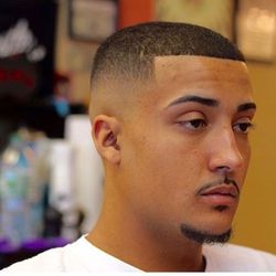 Jordan Williamson - Axe To Grind Barbershop & Supply Co.