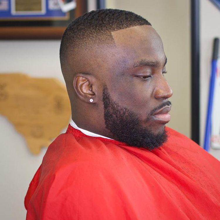 Mid bald fade.