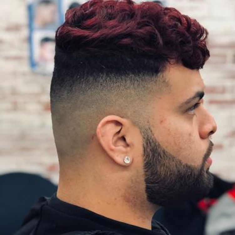 High skin fade with a line up on the top beard for a crispy touch
