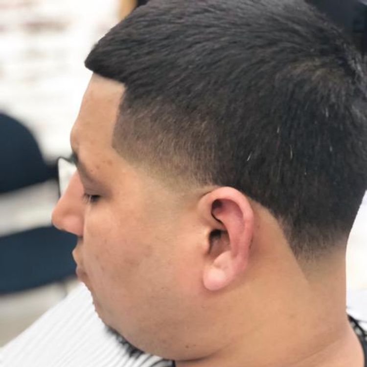 Taper fade with a double zero on the sides and back