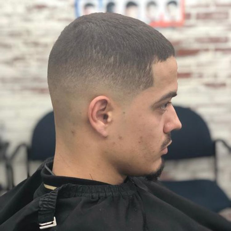 Mid fade with edge up on the side execpt on top, natural
