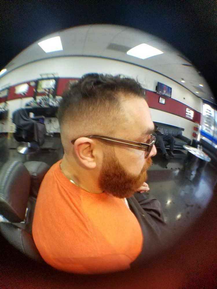 Light 000 Fade with beard trimming.