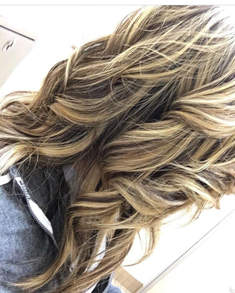 She was a very dark brown black (used box color) and we lifted her this light with olaplex !