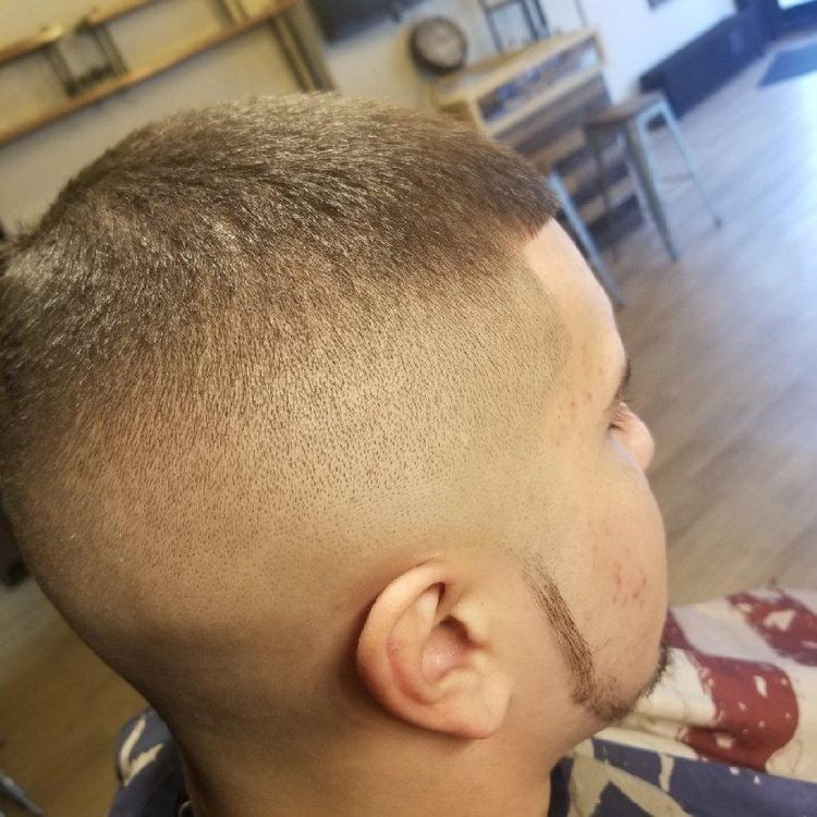 Skin Fade with a number five on top